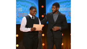 Usher presents full scholarship to UNCF scholar, Ammon Lyle(Photo: Mark Davis/Getty Images for BET)